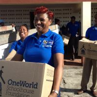 Grenada 2013. Mrs. Champa Barnes, Royal Bank manager in Grenada–and her staff bring our books to Gouyave. image