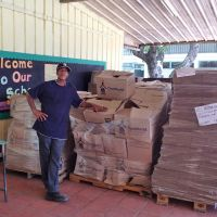 St. Lucia 2012. Clement, the school custodian, has the task of distributing boxes of books at Soufrière Primary image