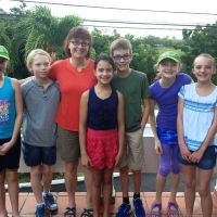 Students from an independent school in Waterloo Region and supervising teacher, Carey Gallagher, volunteered their help at Rainforest of Reading festivals in St. Lucia and Grenada. image