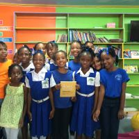 Filling the shelves with donated books in the library at Laborie Girls RC Primary School in St. Lucia. image