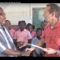 Local TV covered the event. Pius Bastien–Desruisseaux School principal–offers Richard the
