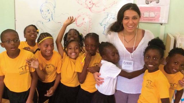 Illustrator Gabrielle Grimard with new friends from Elizabeth Pemberton School in Gingerland, Nevis. image