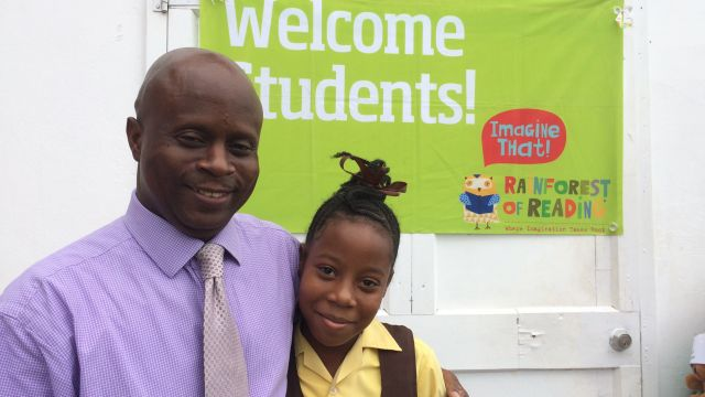 Wakeley Daniel, Permanent Secretary, Office of the Premier and his daughter attended the first Rainforest of Reading in Nevis. image
