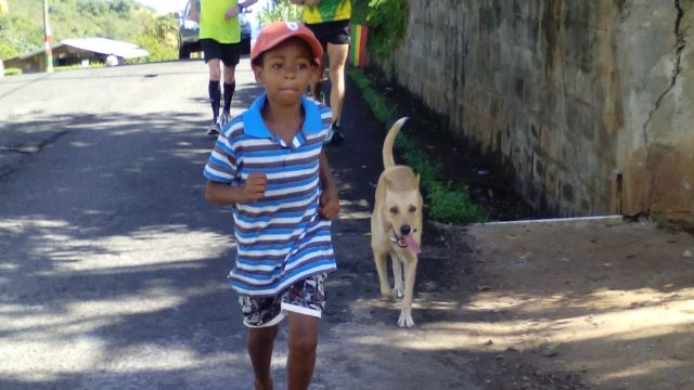 Day 2: Mile 37. We are joined by a fellow – and barefoot – runner on his way to his grandfather's house. image